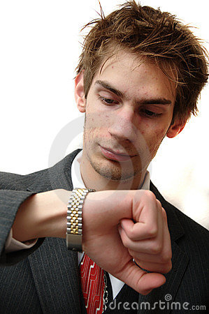 Attractive Young businessman checks time