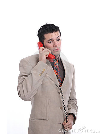 Attractive young businessman on the phone