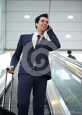 Attractive young businessman talking on mobile phone