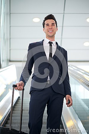 Attractive young businessman traveling with bag