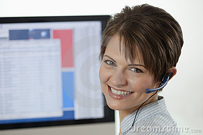 Attractive Young Businesswoman with a Headset
