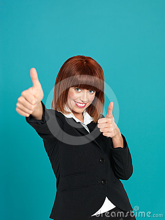 Attractive, young businesswoman showing ok sign