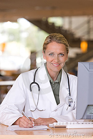 Attractive young caring doctor