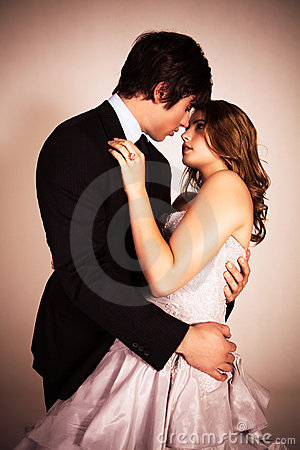 Free Attractive Young Couple Embracing For A Kiss Stock Photography - 15082702
