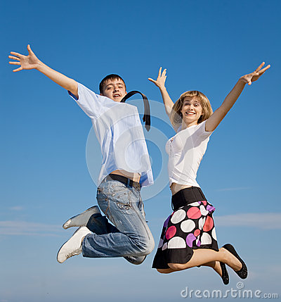 Attractive young couple jumping
