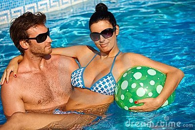 Attractive young couple in swimming pool