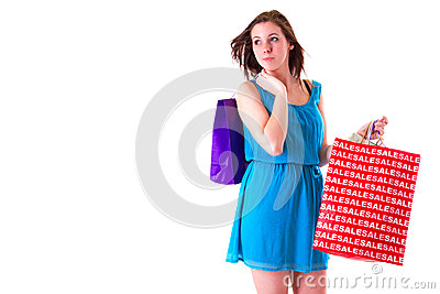 Attractive young female holding shopping bags