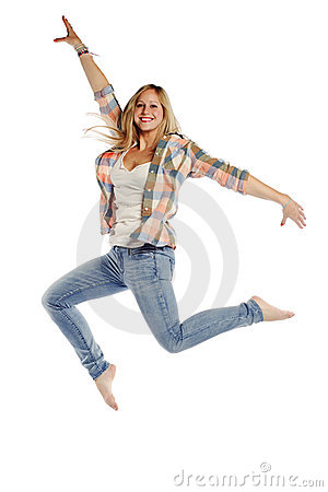 Attractive young female jumping with joy on white