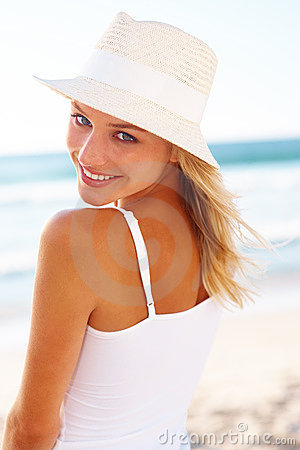 Attractive young female wearing a straw hat