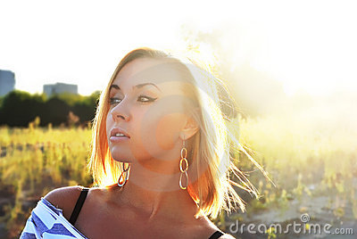 Attractive young girl in beautiful sunshine