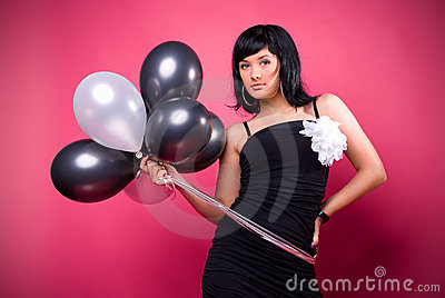 Attractive young girl with birthday balloons