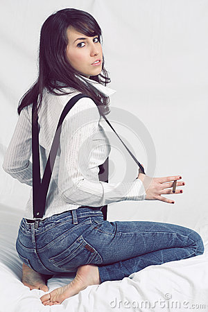 Attractive young girl posing with suspenders