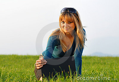 Attractive young girl working on computer in nature