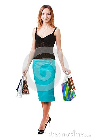 Attractive young lady in blue skirt with packets