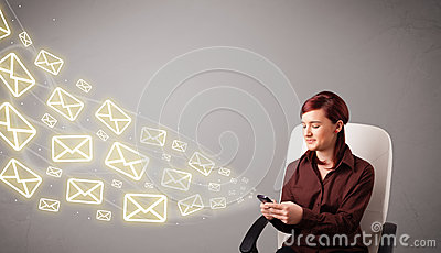 Attractive young lady holding a phone with message icons