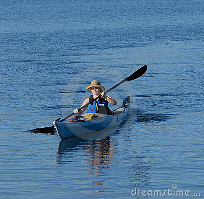 Free Attractive Young Lady Kayaking Royalty Free Stock Images - 3345929