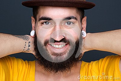 Attractive young man with beard smiling