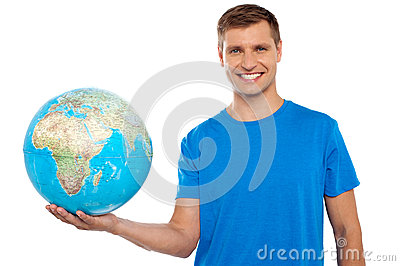 Attractive young man holding globe in his hand