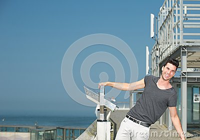 Attractive young man laughing outdoors