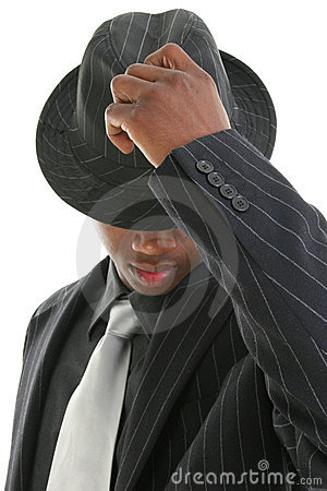Attractive Young Man In Pinstripe Suit Tipping His Hat