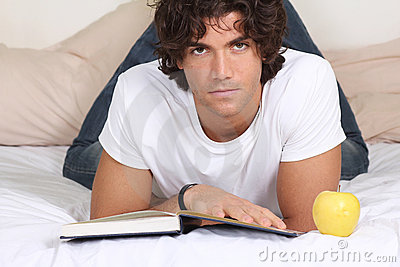 Attractive young man read a book