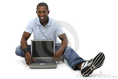 Attractive Young Man Sitting On Floor with Laptop Computer