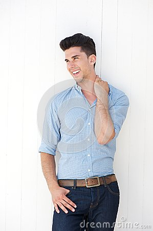 Attractive young man smiling against white background