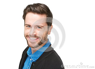 Attractive young man smiling on isolated white background