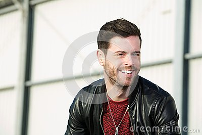 Attractive young man smiling outdoors