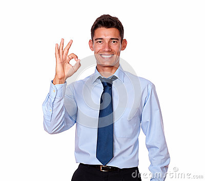 Attractive young man standing with ok gesture