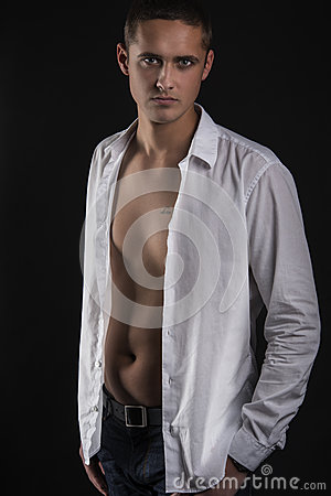 Sexy young man in white shirt