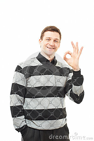 Attractive young man in sweater showing thumb up