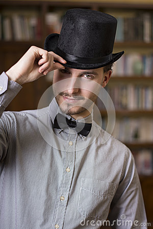 Free Attractive Young Man Wearing Top Hat And Bow Tie Royalty Free Stock Photos - 37899878