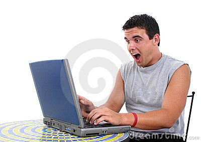 Attractive Young Man Working On Laptop With S