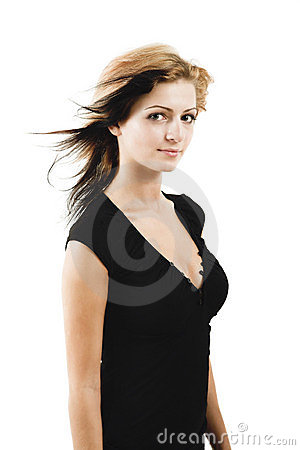 Attractive young model posing in a cute black dress