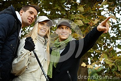Attractive young people hiking in forest smiling