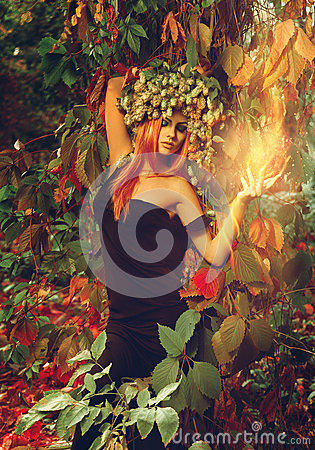 Free Attractive Young Read Hair Lady Wizard With Hop On Head Royalty Free Stock Image - 60638036