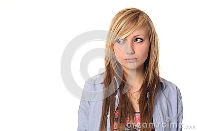 Attractive young teenage girl looking sideways