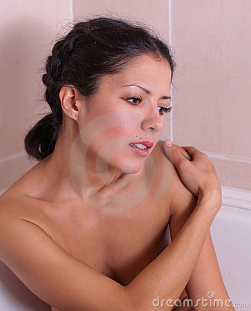 Attractive young woman in bath