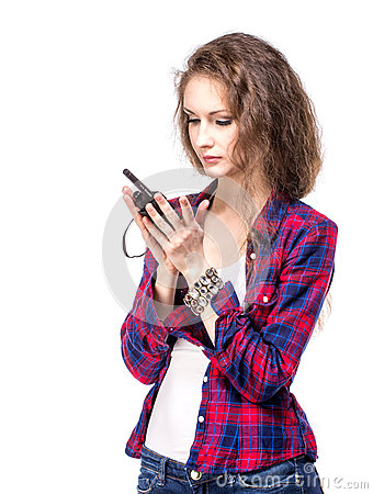 Attractive young woman in a checkered shirt with walkie talkie,