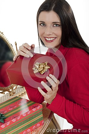 Attractive young woman with Christmas presents