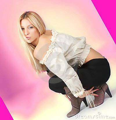 Attractive young woman crouching