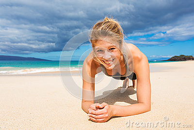 Attractive Young Woman Doing Push Up Exercise