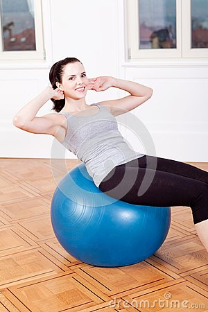 Attractive young woman doing sit ups