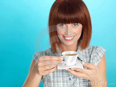 Attractive young woman drinking an espresso coffee