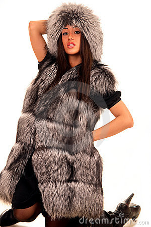 Attractive young woman in expensive fur coat