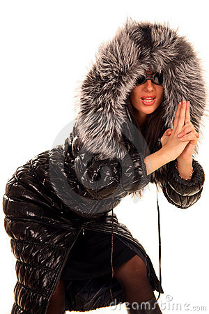 Attractive young woman in fur coat, posing