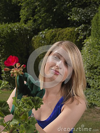 Attractive young woman gardener