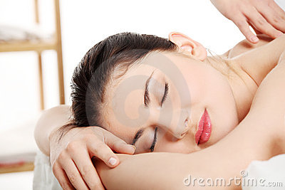Attractive young woman getting spa treatment