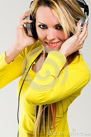 Attractive young woman with headphones over white